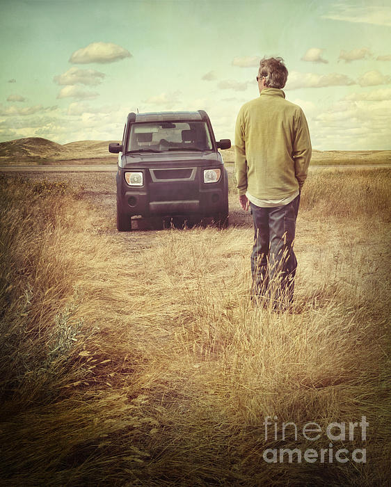 Man Standing In Front Of Car In Field Print by Sandra Cunningham