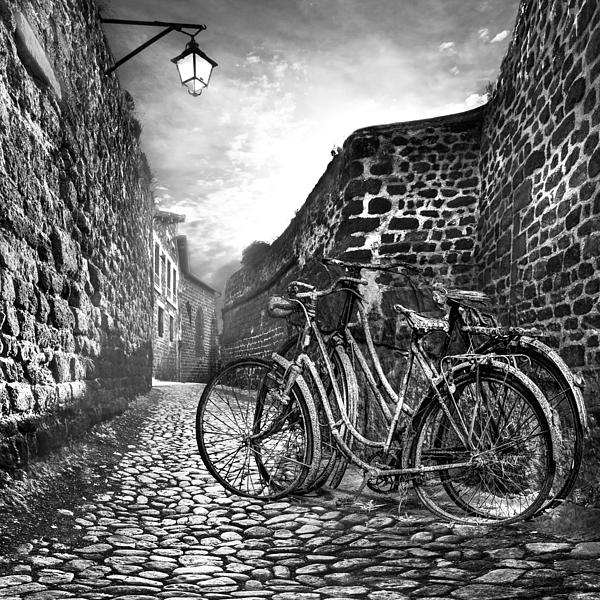 Old Bicycles On A Sunday Morning Print by Debra and Dave Vanderlaan