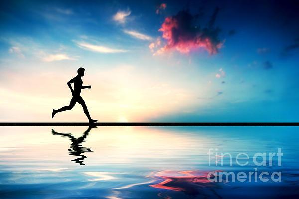 Silhouette Of Man Running At Sunset Print by Michal Bednarek
