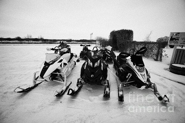 snowmobiles parked in Kamsack Saskatchewan Canada Print by Joe Fox