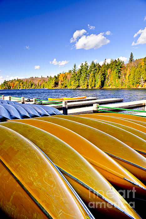 Canoes On Autumn Lake Print by Elena Elisseeva