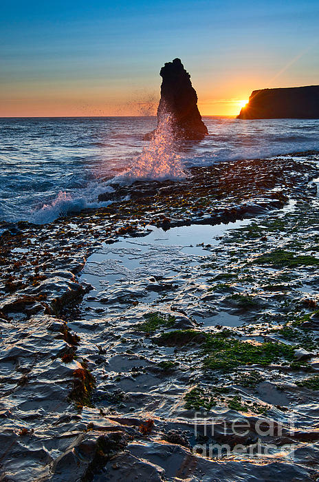 Jamie Pham - Dramatic view of a sea stack in Davenport Beach Santa Cruz.
