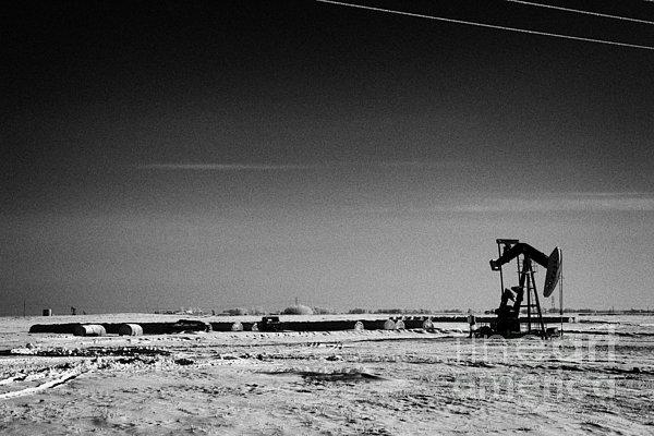 snow covered prairie agricultural farming land with pumpjacks oilfield winter Forget Saskatchewan Ca Print by Joe Fox