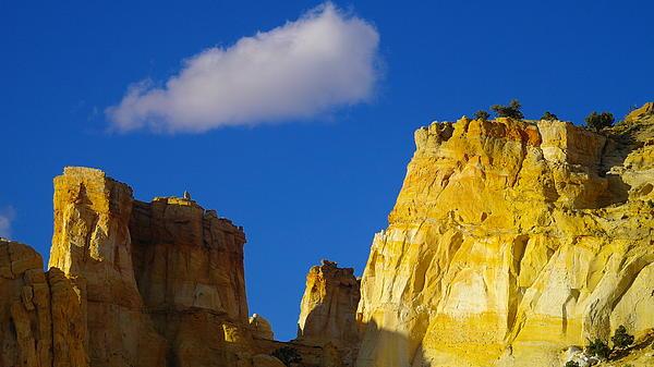 A Cloud Over Orange Rock Print by Jeff  Swan
