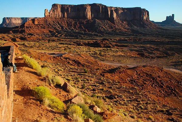 A Couple Enjoys Sunrise At The Monument Valley Tribal Park Hotel Overlook In Utah Print by Robert Ford
