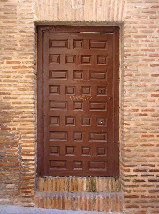 A Door In Toledo Print by Roberto Alamino