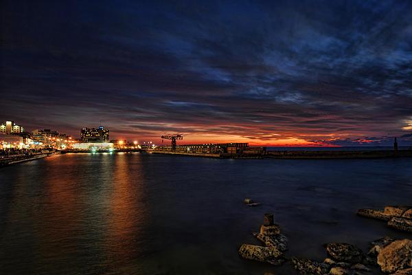 a flaming sunset at Tel Aviv port Print by Ron Shoshani