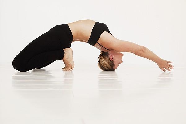 A Woman In A Yoga Pose Tarifa, Cadiz Print by Marcos Welsh