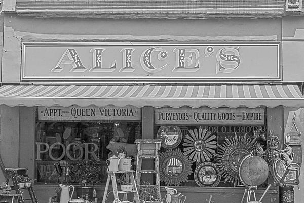 Alice's Antiques In Black And White Print by Nomad Art And  Design