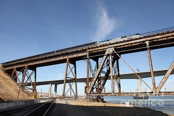 Amtrak Train Riding Atop The Benicia-martinez Train Bridge In California - 5d18775 Print by Wingsdomain Art and Photography