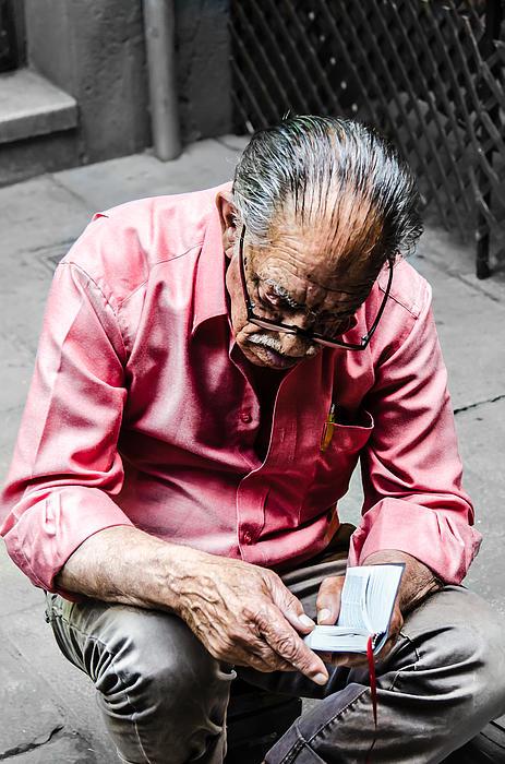 An Old Man Reading His Book Print by Sotiris Filippou