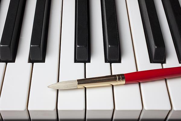 Artist Brush On Piano Keys Print by Garry Gay