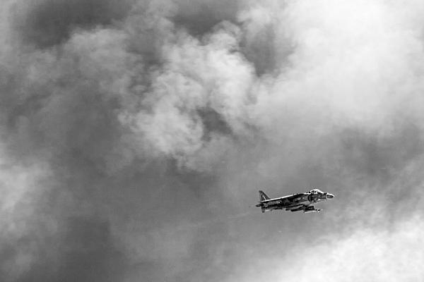 Av-8b Harrier Flies Through The Smoke Of War Print by Peter Tellone