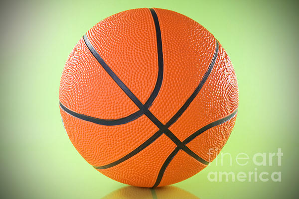 Basketball Ball Over A Green Background Print by G J