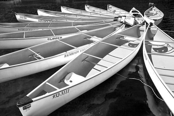 Randall Nyhof - Black and White Photograph of a group of canoes tethered together in a circle