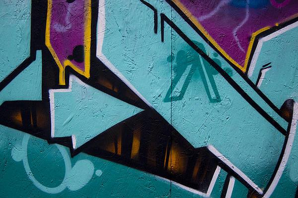 Blue Graffiti Arrow Print by Carol Leigh