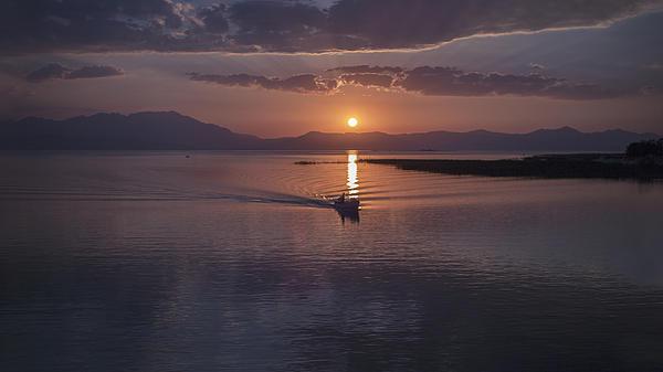 Boat In Sunset Print by Yavuz Sariyildiz