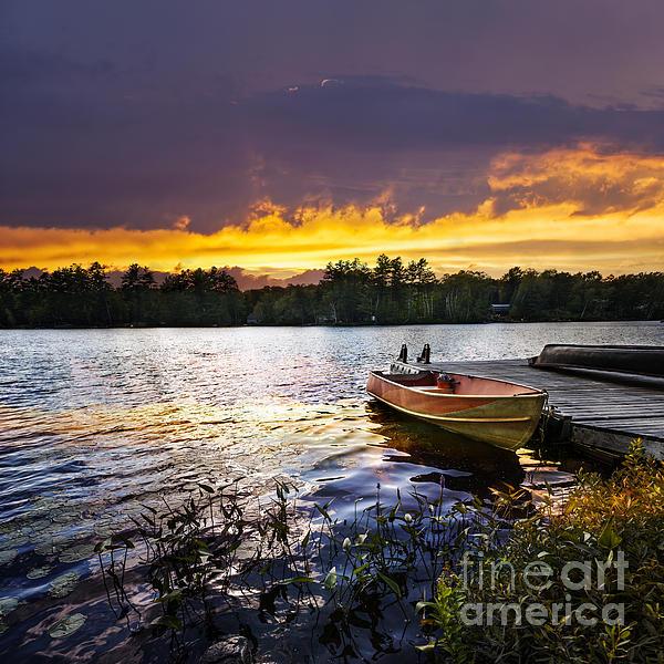 Boat On Lake At Sunset Print by Elena Elisseeva