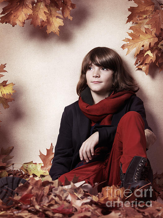 Boy Sitting On Autumn Leaves Artistic Portrait Print by Oleksiy Maksymenko