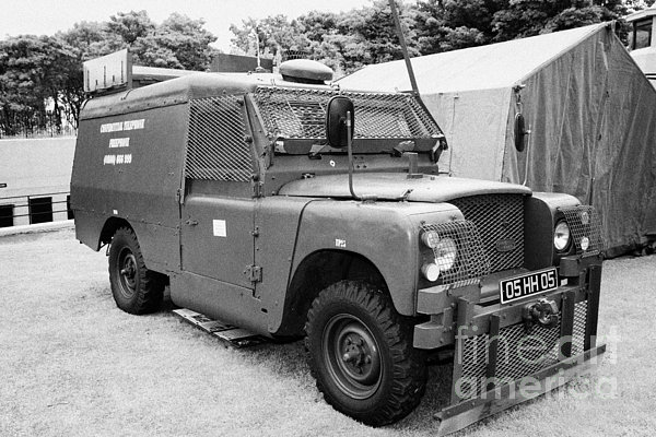 British Army Armoured Land Rover At Grey Point Fort Helens Bay County Down Northern Ireland Print by Joe Fox