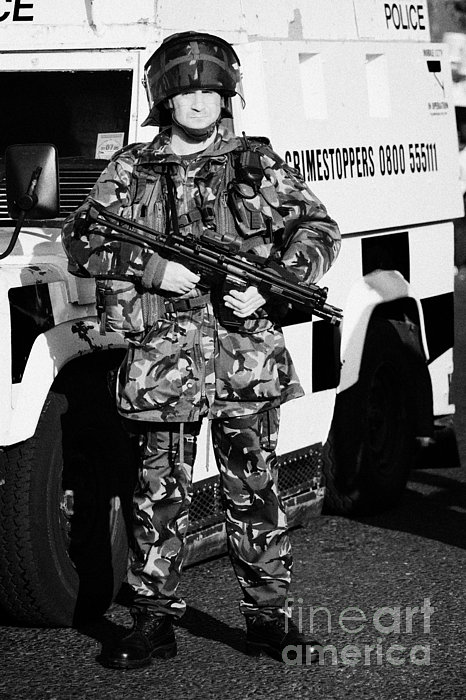 British Army Soldier With Mp5 On Crumlin Road At Ardoyne Shops Belfast 12th July Print by Joe Fox