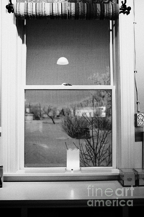 Candle In The Window Looking Out Over Snow Covered Scene In Small Rural Village Print by Joe Fox