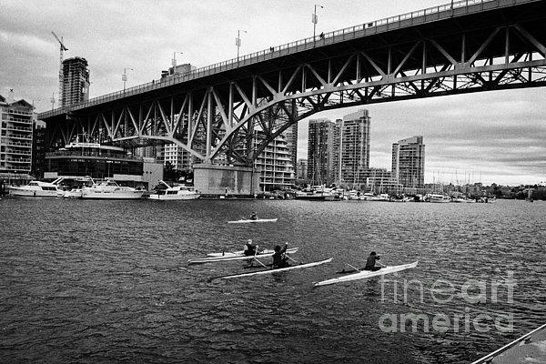 canoeists canoeing along false creek underneath the granville bridge Vancouver BC Canada Print by Joe Fox