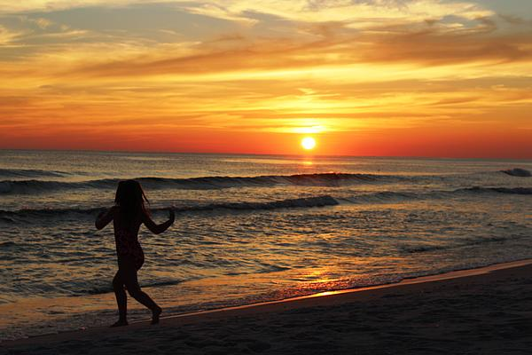 Child Running On Beach At Sunset Print by Vicki Kennedy