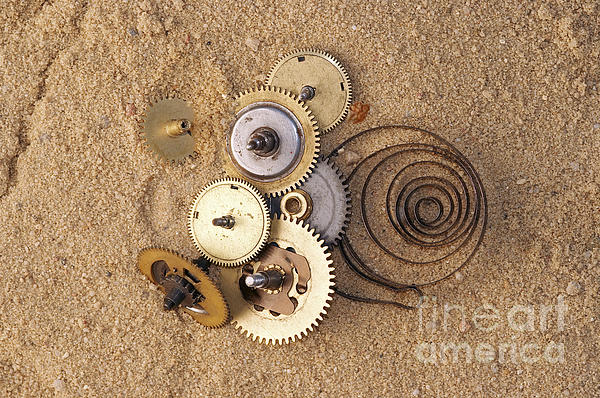 Clockwork Mechanism On The Sand Print by Michal Boubin