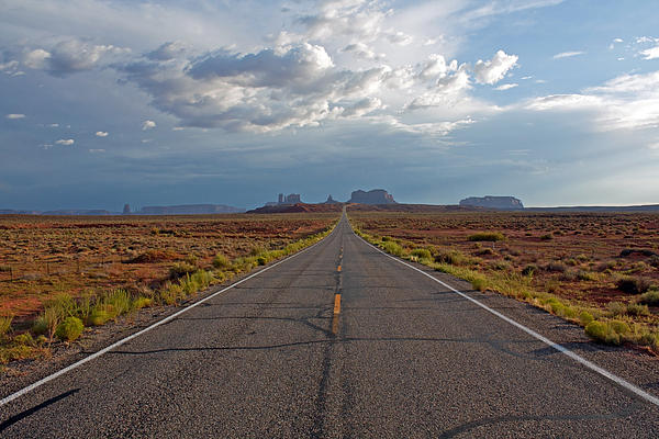 Clouds Over Monument Valley Print by Chris Flack Desert Images
