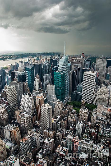 cloudy Manhattan Print by Hannes Cmarits