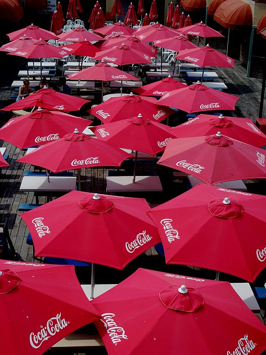 Coca Cola Red Umbrella's Print by Rick Todaro