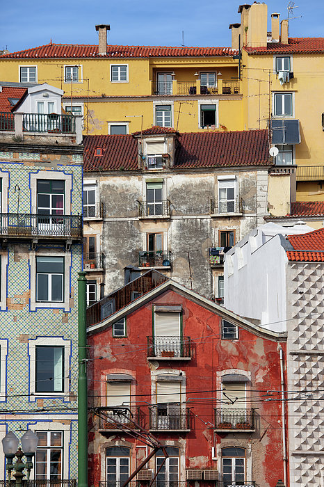 Colorful Houses In The City Of Lisbon Print by Artur Bogacki
