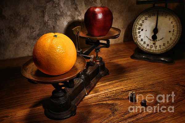 Comparing Apple And Orange Print by Olivier Le Queinec