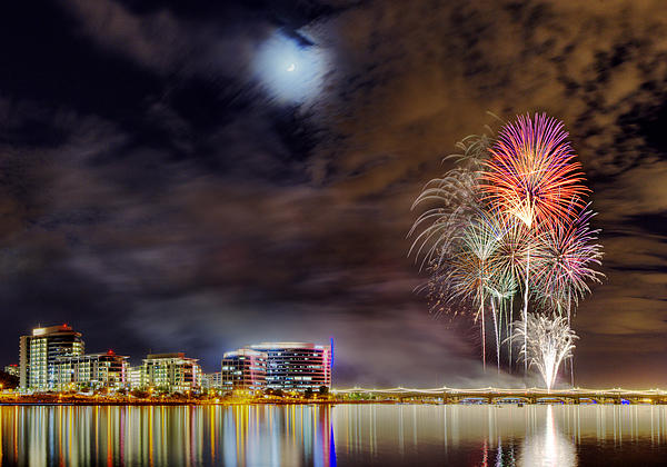 Crescent Moon And Fireworks Over Tempe Town Lake Print by  Reid Helms