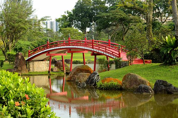 Curved Red Japanese Bridge And Stream Print by Imran Ahmed