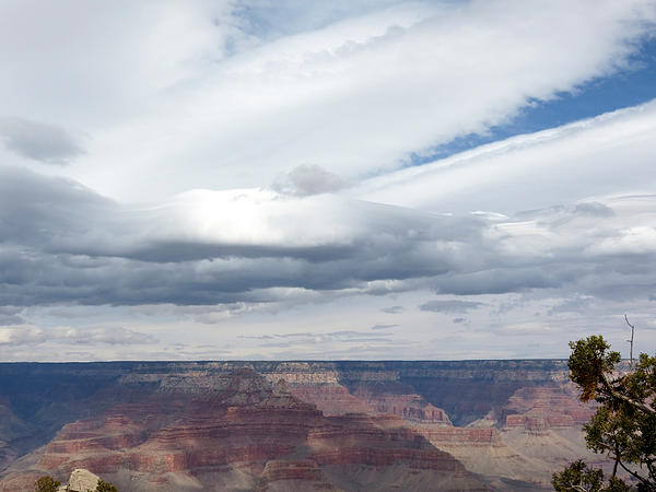 Dramatic Clouds Over The Grand Canyon Print by Laurel Powell