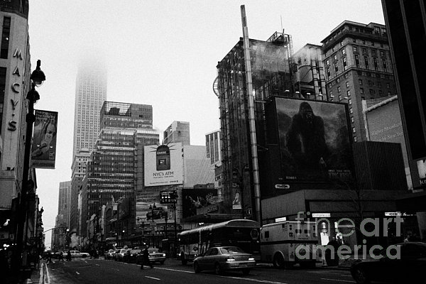 empire state building shrouded in mist from west 34th Street and 7th Avenue new york city usa Print by Joe Fox