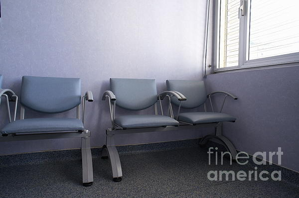 Empty Seats In A Waiting Room Print by Sami Sarkis