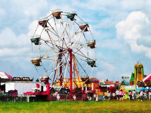 Ferris Wheel Against Blue Sky Print by Susan Savad