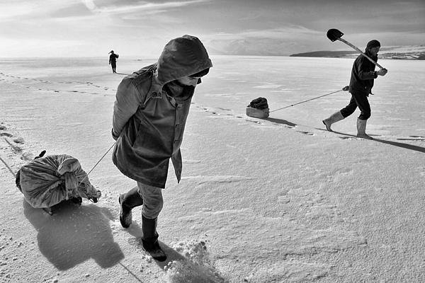 Fishermen On Frozen Lake Print by Yavuz Sariyildiz