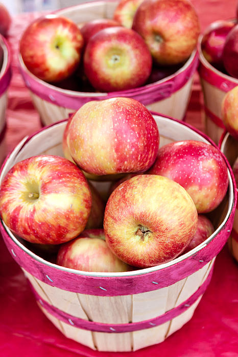 Fresh Apples In Buschel Baskets At Farmers Market Print by Teri Virbickis