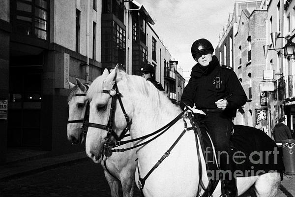 Garda Siochana Mounted Police On Horseback In Temple Bar Dublin Republic Of Ireland Print by Joe Fox