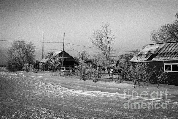 hoar frost covered street in small rural village of Forget Saskatchewan Canada Print by Joe Fox