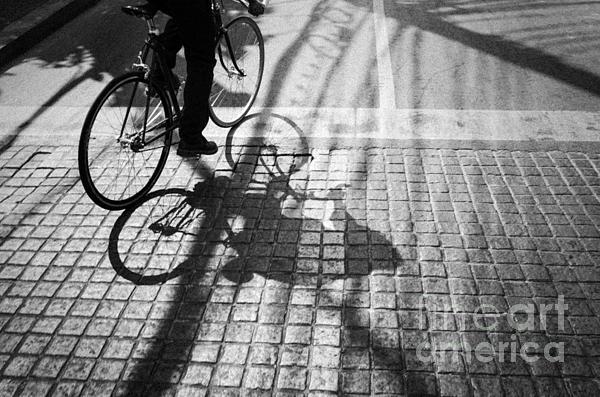 Light And Shadow Of A Man Ride The Bicycle Print by Setsiri Silapasuwanchai
