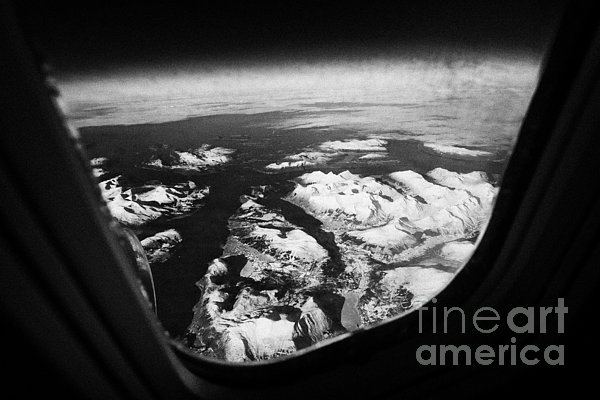 Looking Out Of Aircraft Window Over Snow Covered Fjords And Coastline Of Norway  Print by Joe Fox