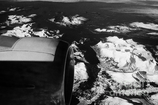 Looking Out Of Aircraft Window Past Engine And Over Snow Covered Fjords And Coastline Of Norway Euro Print by Joe Fox