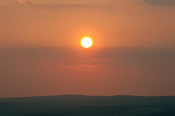 Low Setting Sun Over Distant Landscape Print by Matthew Gibson
