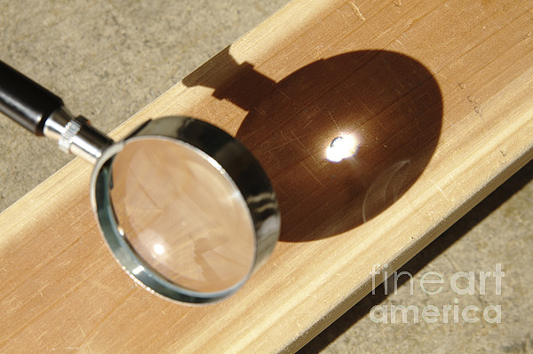 magnifying glass focusing sun light print by giphotostock. Black Bedroom Furniture Sets. Home Design Ideas