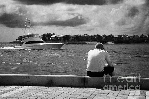 Man Fishing On Mallory Square Seafront Key West Florida Usa Print by Joe Fox